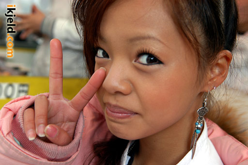 Japanese Woman Showing Peace Sign