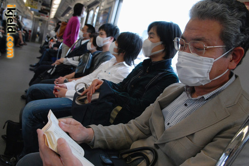 Japanese Train Passengers Wearing Masks