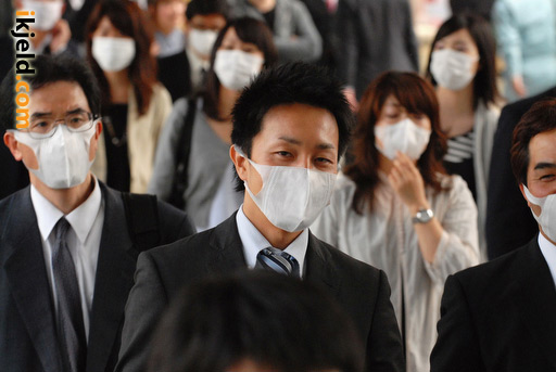Japanese Businessmen Wearing Masks