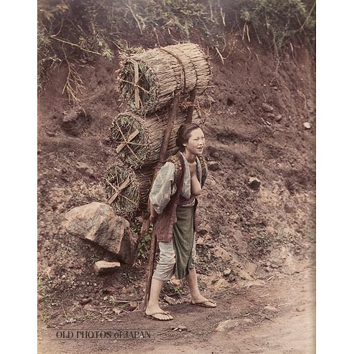 1890s  Woman Carrying Charcoal